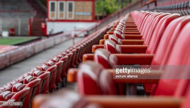 """April 2020, Berlin: The seats in the rows of the deserted stadium """"An der Alten Försterei"""", the home stadium of 1.FC Union Berlin, the Bundesliga..."""