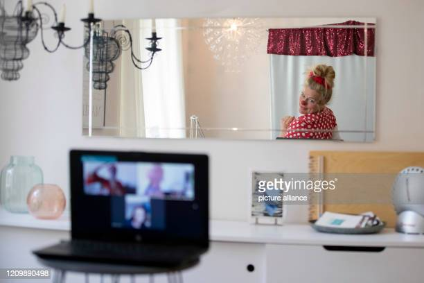 Clinic clown Vitamins from the association Lachen hilft bourgeois Ute von Koerber can be seen in a mirror in her apartment during her appearance at...