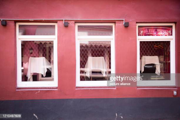 April 2020, Hamburg: No prostitutes sit in the windows of a brothel in the legendary Herbertstraße on St. Pauli. The red-light district is not yet...