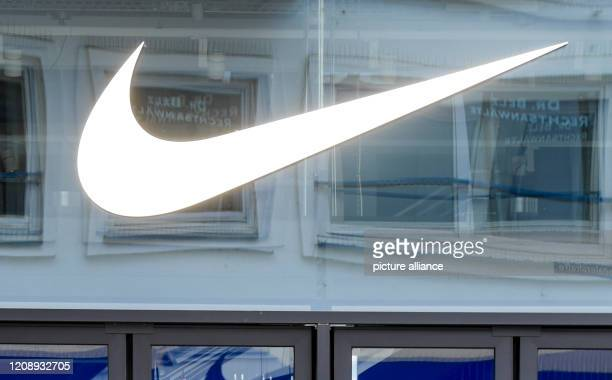 April 2020, Hamburg: The logo of the sporting goods manufacturer Nike hangs above the entrance of the department store in downtown Hamburg. Photo:...