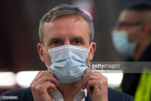 April 2020, North Rhine-Westphalia, Duesseldorf: Thomas Geisel , Lord Mayor of Düsseldorf, puts on a face mask. The Rheinbahn in Düsseldorf...