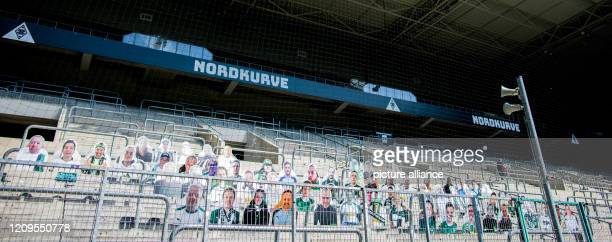"April 2020, North Rhine-Westphalia, Mönchengladbach: The first ""cardboard comrades"" - fans of Borussia Mönchengladbach - are installed on the north..."