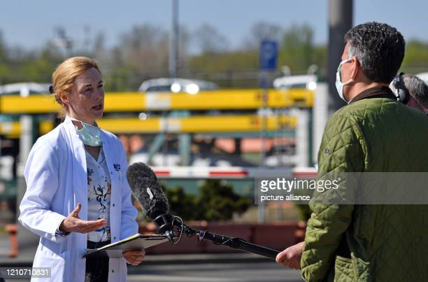 April 2020, Saxony, Zwickau: Katrin Beck, Head of Healthcare at Volkswagen Sachsen, gives an interview to a television team on the premises of the...