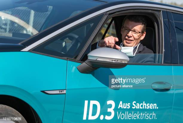 April 2020, Saxony, Zwickau: Reinhard de Vries, Managing Director of Technology and Logistics at Volkswagen Sachsen, sits in an ID.3 on the premises...