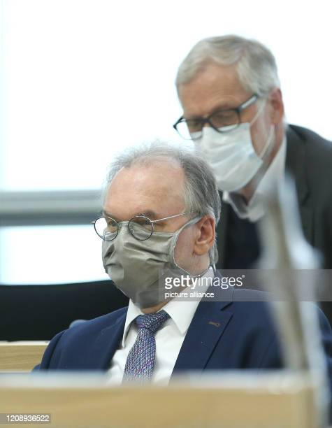 SaxonyAnhalt's Prime Minister Reiner Haseloff and SaxonyAnhalt's Minister of Culture Rainer Robra wear face masks on the government bench during the...