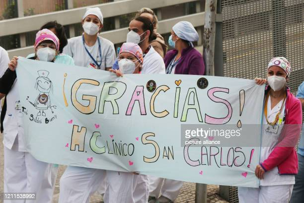 April 2020, Spain, Madrid: Sanitary workers of the Hospital San Carlos, get out of the building as every day at 8 PM to honour the people and the...