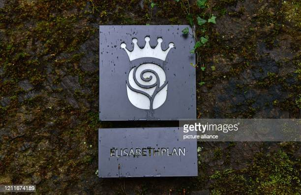 April 2020, Thuringia, Eisenach: A sign marks the Elizabeth Plan, where probably in 1226 Saint Elizabeth founded a hospital. Churches and the city of...