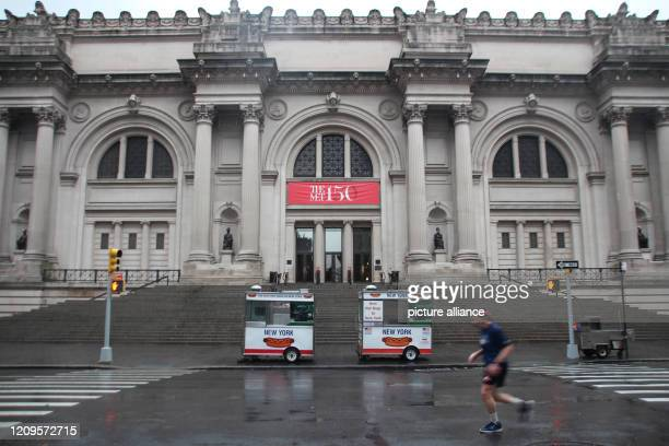 A jogger is running on the empty street in front of the entrance to the Metropolitan Museum According to director Hollein the museum which is...