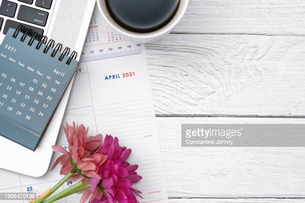 april 2021 calendar on white painted wooden desk - april stock pictures, royalty-free photos & images