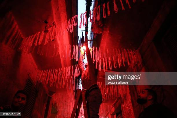 April 2021, Egypt, Giza: People hang Ramadan decorations in a street in al-Baragel village. Muslims around the world are preparing for the holy month...