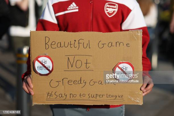 April 2021: Fans display banners at The Emirates opposing Arsenal signing up for the newly proposed Super League on April 19, 2021 in London, United...