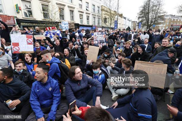 April 2021: Fans gather in huge numbers in the streets to protest the introduction of the European Super League on April 20, 2021 in London, United...