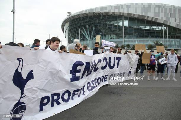 April 2021: Tottenham Hotspur supporters protest about the club owners ENIC and chairman Daniel Levy - fans outside the stadium on April 21, 2021 in...