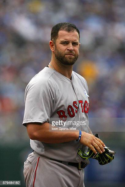 Boston Red Sox first baseman Mike Napoli [6085] removes his batting gloves following a ground out in a 132 win against the Kansas City Royals at...