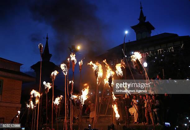 SRINAGAR April 21 2016 Kashmiri villagers hold torches during the torch light festival outside the shrine of a sufi saint Zainuddin Wali in Aishmuqam...