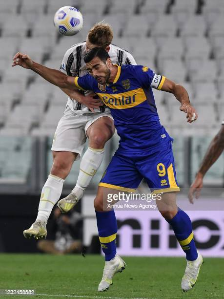 April 21, 2021 -- Juventus' Matthijs De Ligt L vies with Parma's Graziano Pelle during a serie A football match between FC Juventus and Parma in...