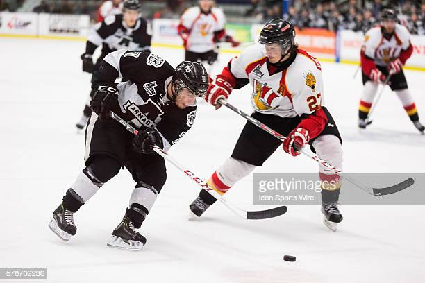 Gabriel Verpaelst of the Baie-Comeau Drakkar tries to outplay Samuel Hodhod of the Blainville-Boisbriand Armada in game 3 during the third round of...