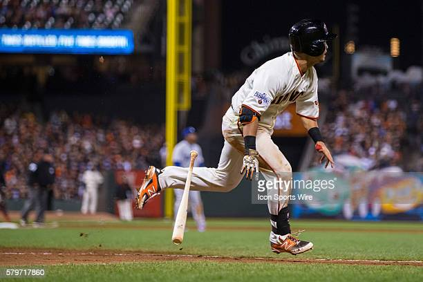 San Francisco Giants left fielder Nori Aoki follows the trajectory of the ball after connecting in the 8th inning during a Major League Baseball game...