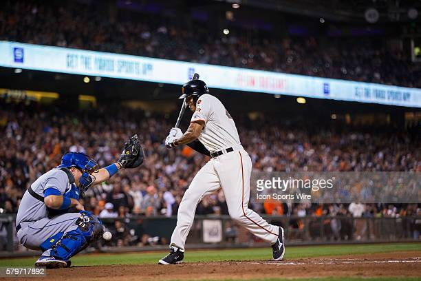 San Francisco Giants right fielder Justin Maxwell is hit by the ball which also injured Los Angeles Dodgers catcher AJ Ellis who had to leave the...