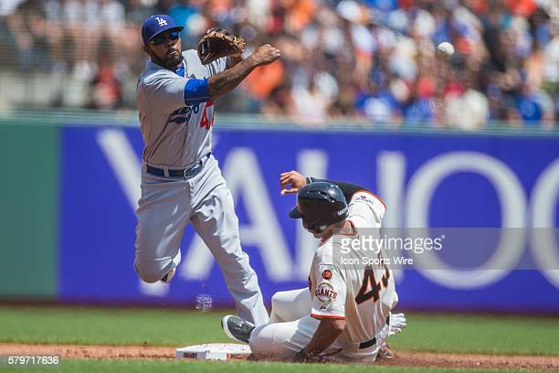 San Francisco Giants right fielder Justin Maxwell slides into 2nd base too late as Los Angeles Dodgers second baseman Howie Kendrick makes the double...