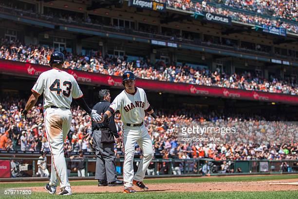 San Francisco Giants second baseman Joe Panik celebrates scoring wing San Francisco Giants right fielder Justin Maxwell in the 6th inning during a...