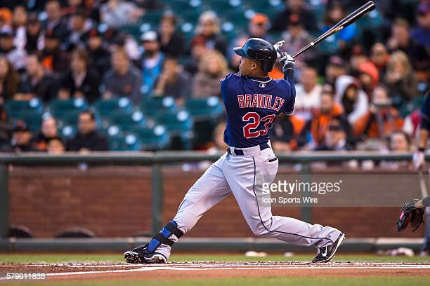 Cleveland Indians left fielder Michael Brantley at the plate and rolling the trajectory of the ball during the game between the San Francisco Giants...