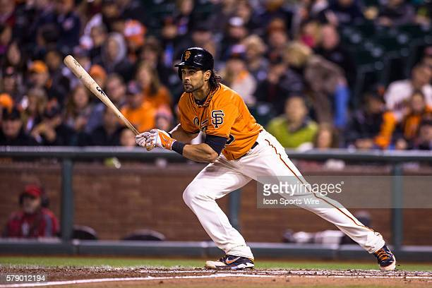 San Francisco Giants center fielder Angel Pagan at home plate following the trajectory of the ball as he runs towards first base during the game...
