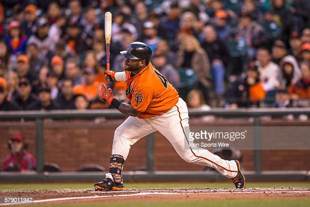 San Francisco Giants third baseman Pablo Sandoval at home plate as he follows the trajectory of the ball after hitting a single during the game...