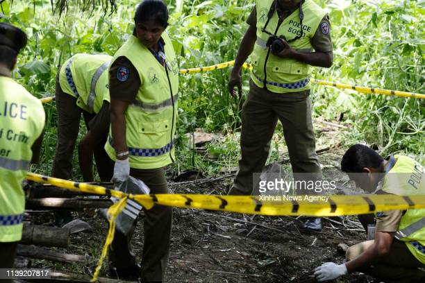 COLOMBO April 25 2019 Police officers work at the explosion site in Pugoda on the east outskirts of Sri Lankan capital Colombo April 25 2019 A minor...