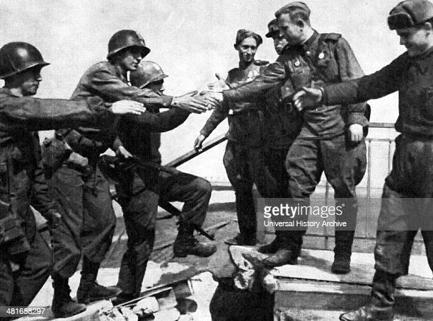 April 25 Soviet and American troops meet at the River Elbe near Torgau in Germany marking an important step toward the end of World War II in Europe