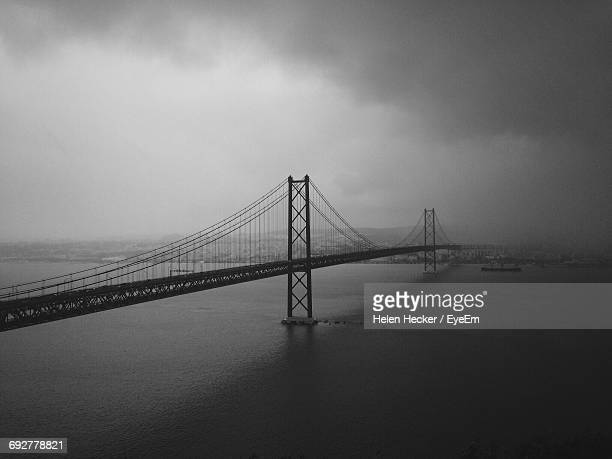 April 25th Bridge Over Tagus River Against Cloudy Sky