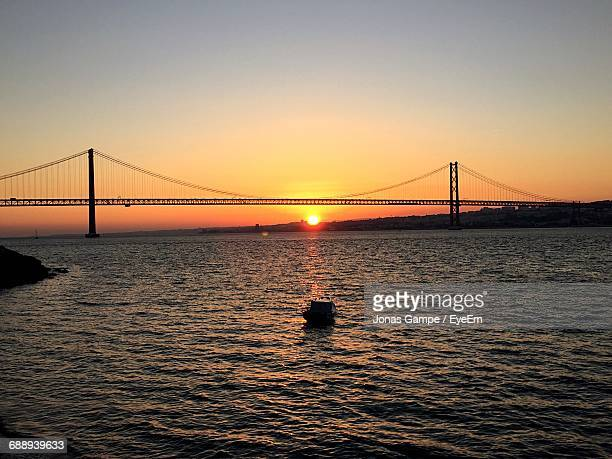 April 25th Bridge Over Tagus River Against Sky During Sunset