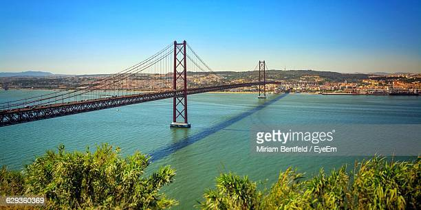 April 25Th Bridge Over Tagus River By City Against Clear Sky
