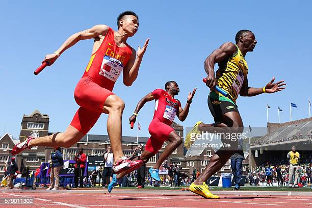 China's Yang Yang USA's Rakieem Salaam and Jamaica's Rasheed Dwyer compete during the USA vs the World Men's 4x100 event at the Penn Relays at...