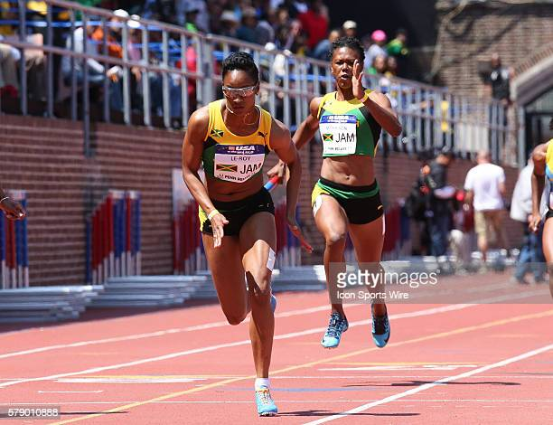 Jamaica's Natasha Morrison hands off to Anastasia LeRoy during the USA vs the World Women Sprint Medley competition at the Penn Relays at Franklin...