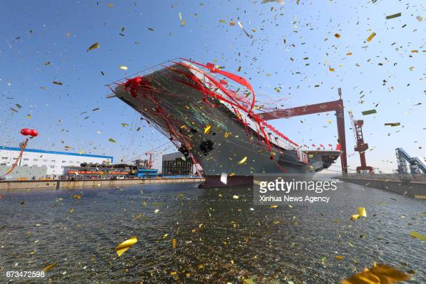 DALIAN April 26 2017 China's second aircraft carrier is transferred from dry dock into the water at a launch ceremony in Dalian shipyard of the China...