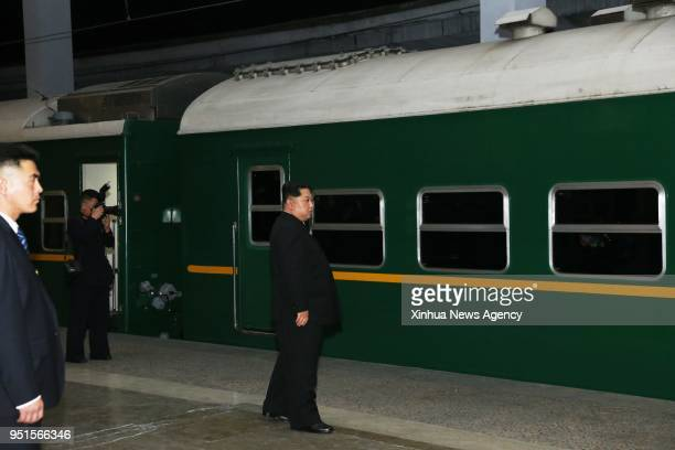 PYONGYANG April 26 2018 Kim Jong Un top leader of the Democratic People's Republic of Korea watches the train leaving the station in Pyongyang the...