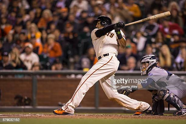 San Francisco Giants left fielder Michael Morse watches the trajectory of the ball after he gets a hit during the game between the San Francisco...
