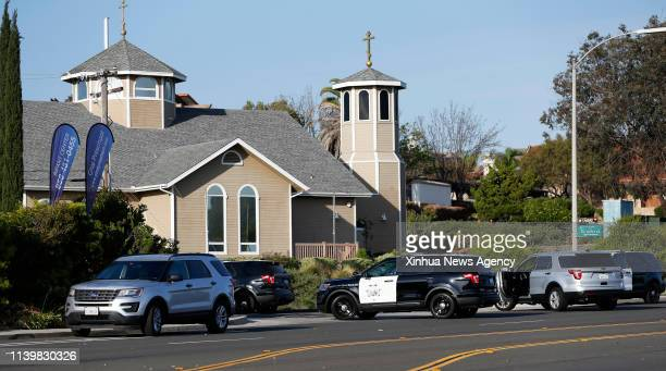 POWAY April 28 2019 Police vehicles gather around the synagogue where a shooting took place in Poway California of the United States April 27 2019...