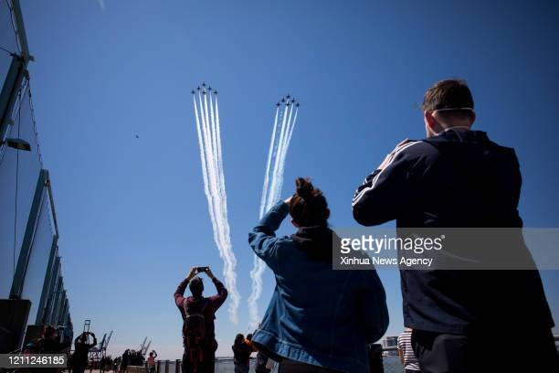 NEW YORK April 28 2020 A formation of the Thunderbirds and Blue Angels fly over New York City the United States on April 28 2020 The US Air Force...