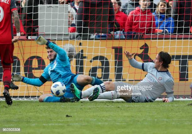 TORONTO ON April 28 In second half action Toronto FC goalkeeper Alex Bono stops an attack late in the match as Alan Gordon puts on some pressure...