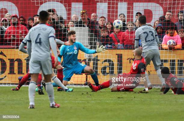 TORONTO ON April 28 In second half action with mere seconds to go in the match Toronto FC goalkeeper Alex Bono watches Alan Gordon's tying goal head...