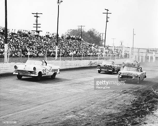 Action during the NASCAR Convertible race at Greensboro Fairgrounds has the No 22 Ford of Glen Wood leading the Buick of Bill Cornwall Tom Pistone's...