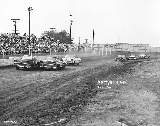 Dave Hirschfield dices with eventual race winner Bob Welborn during the NASCAR Convertible Division race at Greensboro Fairgrounds Trailing the lead...