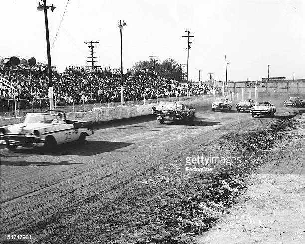 Dink Widenhouse leads Tom Pistone and the rest of the field during the NASCAR Convertible Division race at Greensboro Fairgrounds