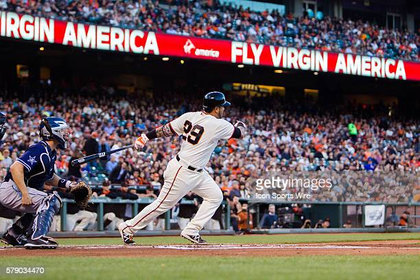 San Francisco Giants catcher Hector Sanchez at bat as he follows the trajectory of the ball on a tworun double during the game between the San...