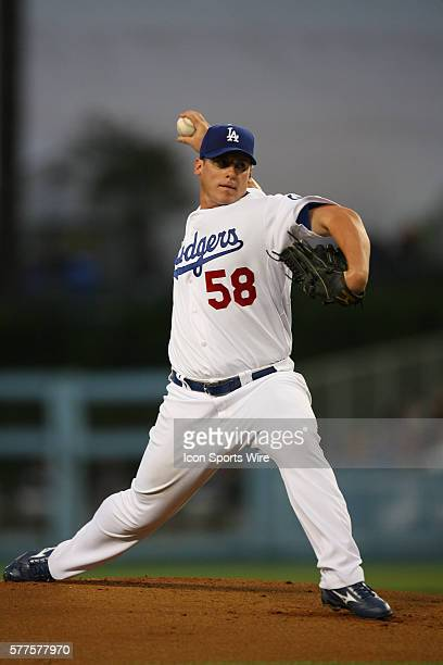 Chad Billingsley of the Los Angeles Dodgers pitches during pre season game against the Milwaukee Brewers at Dodger Stadium in Los AngelesCA