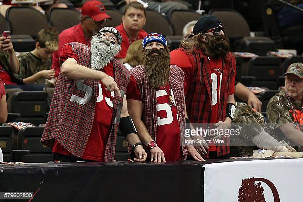 Three fans dress for the Jacksonville Sharks Redneck night promo during the Orlando Predators and the Jacksonville Sharks game at Jacksonville...