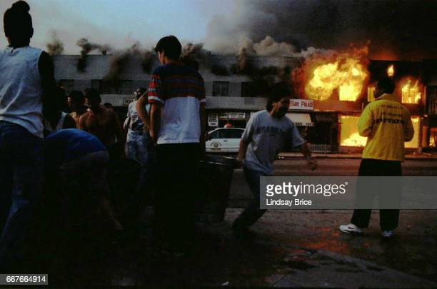 LOS ANGELES April 30 Rodney King Riot Near intersection of Pico Boulevard and Hayworth Avenue neighborhood residents filling buckets from open...
