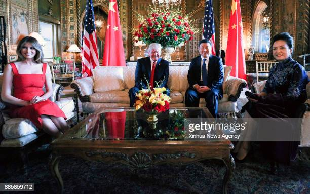 BEACH April 6 2017 Chinese President Xi Jinping his wife Peng Liyuan US President Donald Trump and First Lady Melania Trump meet at the MaraLago...